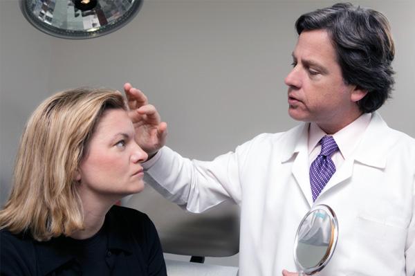Woman having plastic surgery consultation