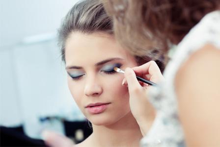 Woman having makeup applies