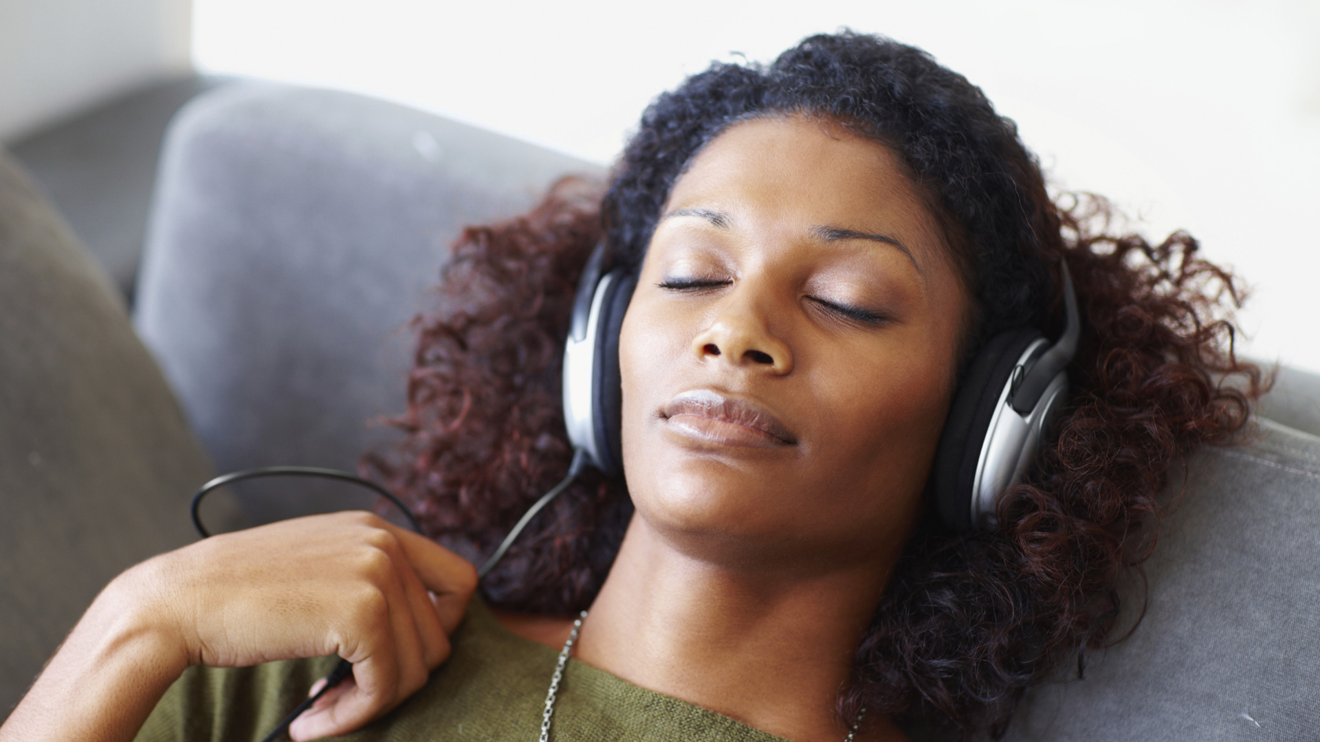 Woman wearing headphones and sleeping