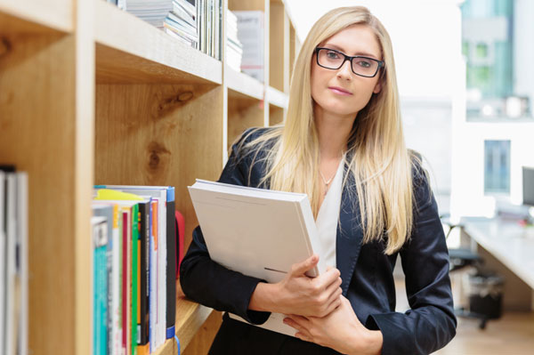 Woman holding books in a library