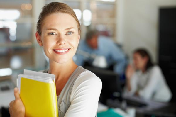 Woman holding folders in office