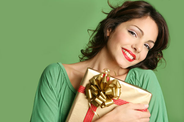 Woman holding holiday gift