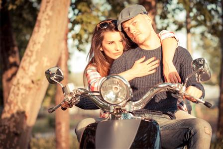 Woman hugging bad boy on motorcycle