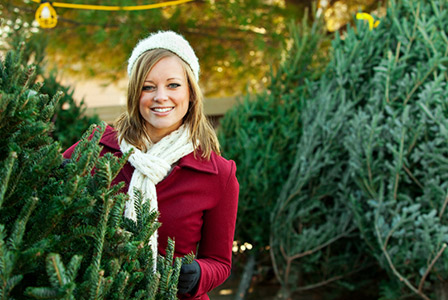 woman in christmas tree lot