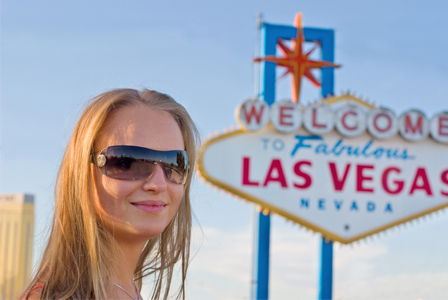 Woman in front of Las Vegas sign