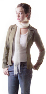 Woman in jeans, blazer and scarf