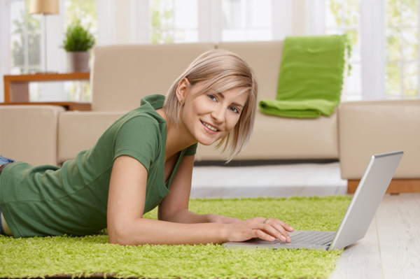 Woman on computer in modern home