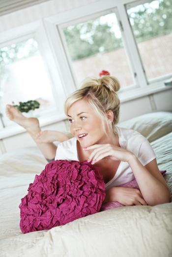 Woman in modern bedroom
