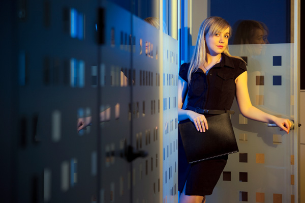 Woman in black dress at office