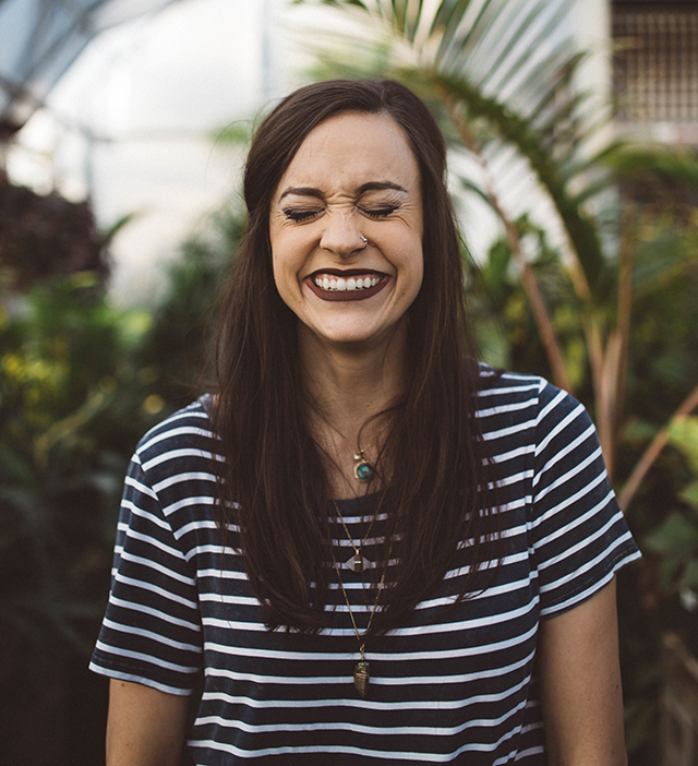 woman in striped shirt smiling