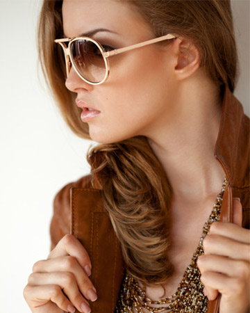 woman in sunglasses and brown leather jacket