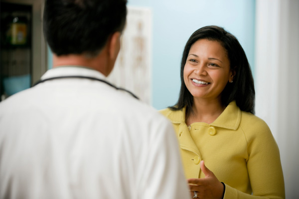 Woman introducing herself to doctor