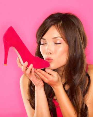 woman kissing high heel