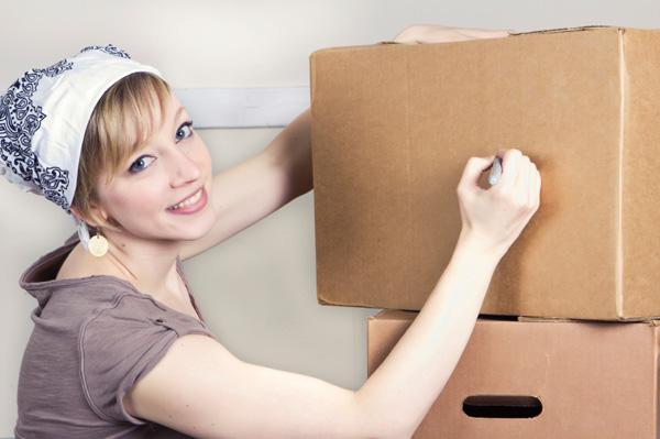 Woman labeling box