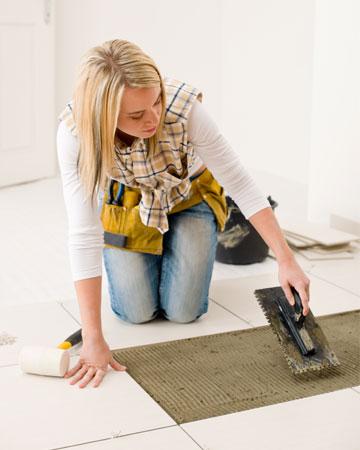 Woman laying tile