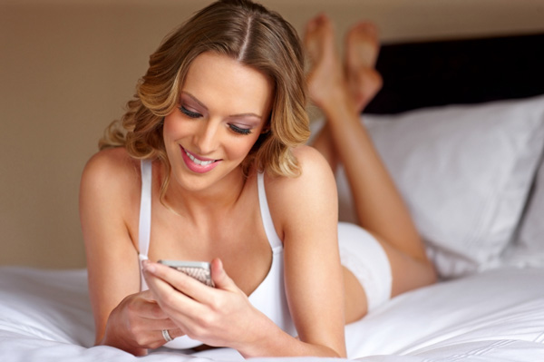 Woman in lingerie on smartphone