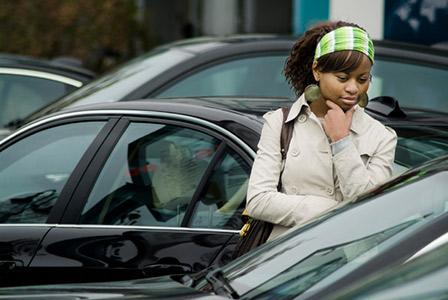 woman looking at cars
