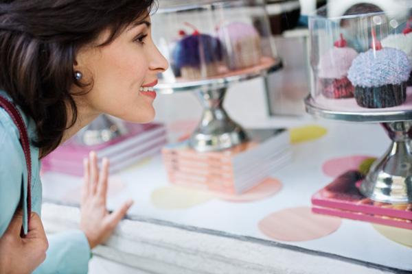 Woman looking at cupcakes