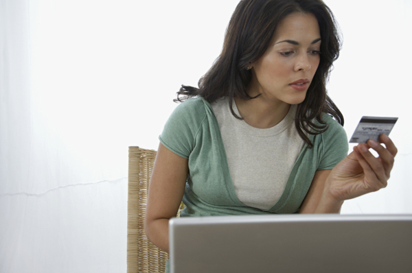 Woman looking at debit card