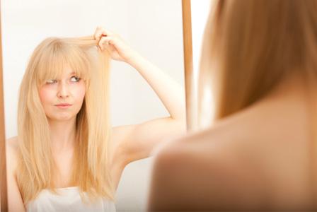 Woman looking at gray hair