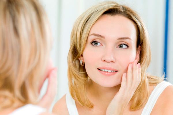 Woman looking at healthy skin