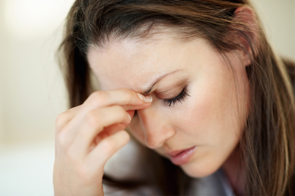 Woman managing migraine