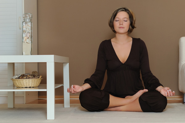 Woman meditating for weight loss