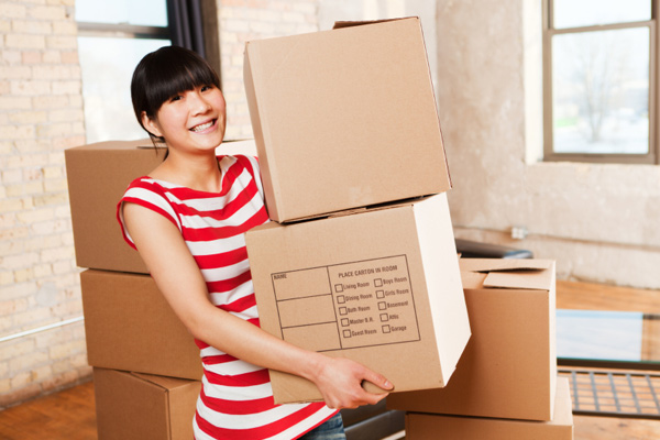 Woman moving into flat