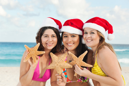 Women on a beach during Christmas