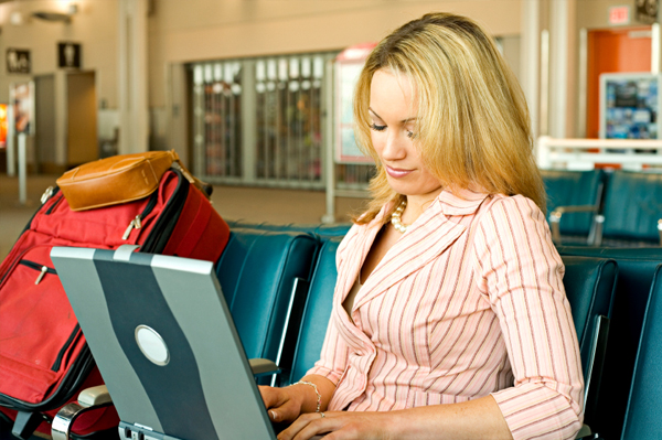 Woman on computer in airport