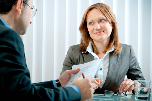 Woman on an interview with her resume
