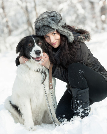 Woman with dog in snow