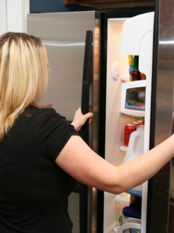 Woman organizing refrigerator