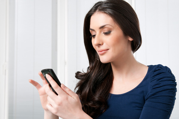 Woman organizng contacts on smartphone