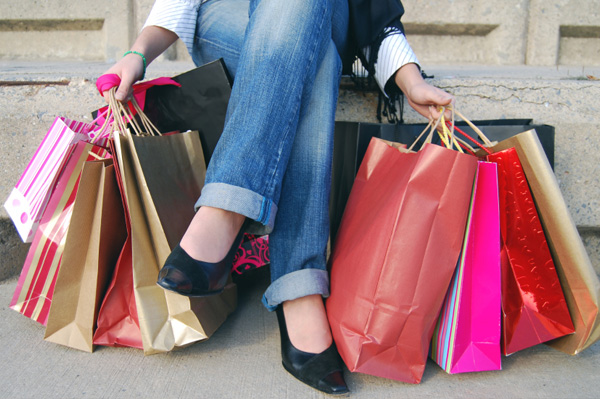 Woman overloaded with shopping bag