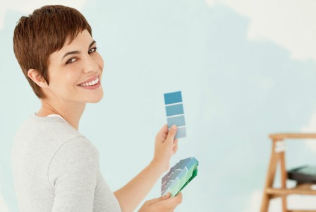 Woman choosing paint colour