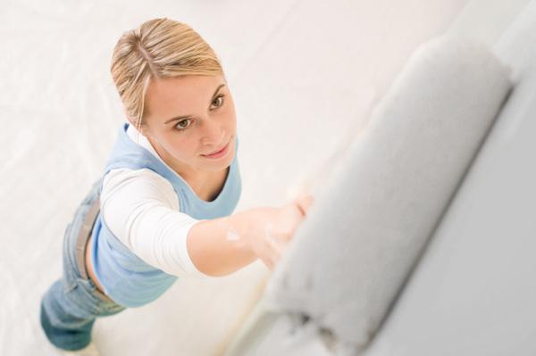 Woman painting garage
