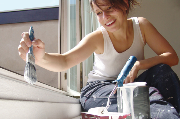 Woman paiting home