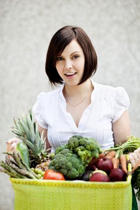 Woman picking up CSA produce