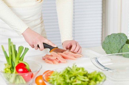 woman preparing chicken