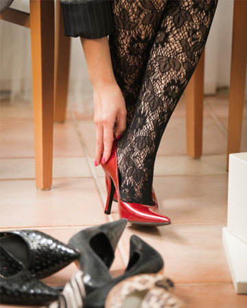 woman putting on heels