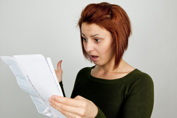 Woman reading credit report