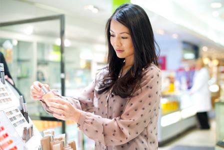 Woman reading makeup labels
