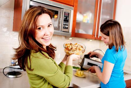 Woman reheating dinner