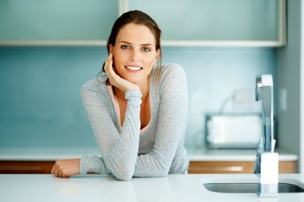 woman relaxing in clean kitchen