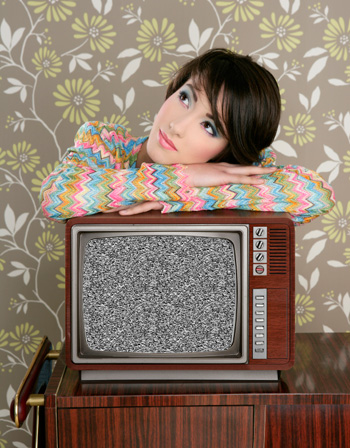 Woman with broken retro tv