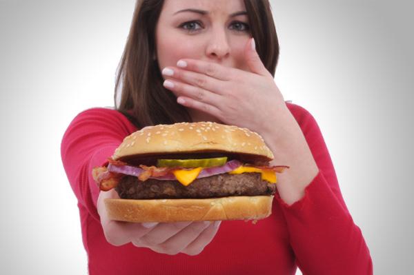 Woman refusing to eat burger