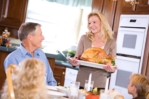 Woman serving Thanksgiving dinner