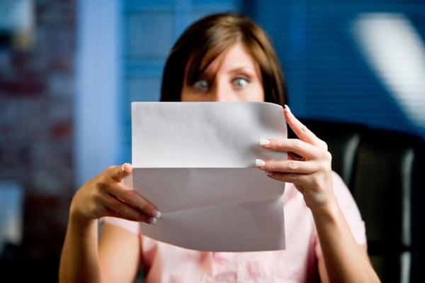 Woman reading medical bill