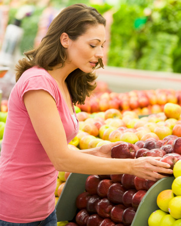 Woman shopping for apples